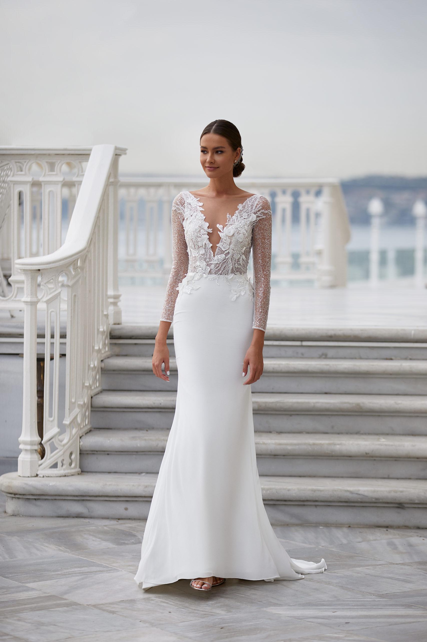 Sublimes robes de mariée à Genève blanc long simple classique chic manches longues broderie fleurs dos nu décolleté genève petit budget pas cher